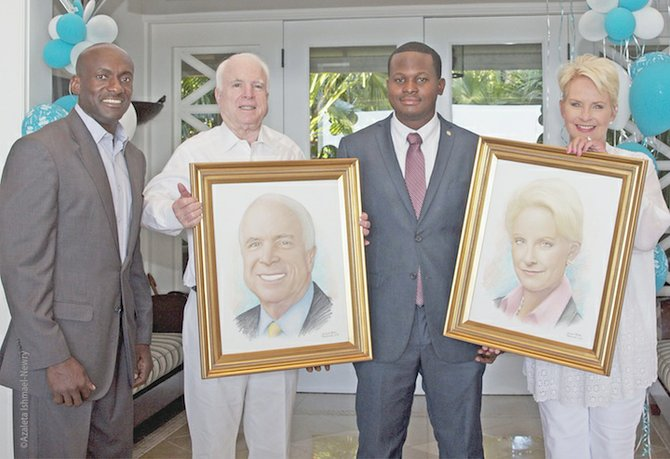 John and Cindy McCain show off the portraits created by Jamaal Rolle and presented by Roni Duncombe, left. Photos: Azaleta Ishmael Newry