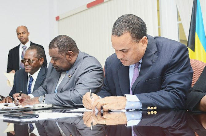 President of The Bahamas Public Service Union (BPSU) John Pinder and Minister of State of Finance Michael Halkitis yesterday signed a new industrial agreement for public servants.Photo: Lamond Johnson/Tribune Staff