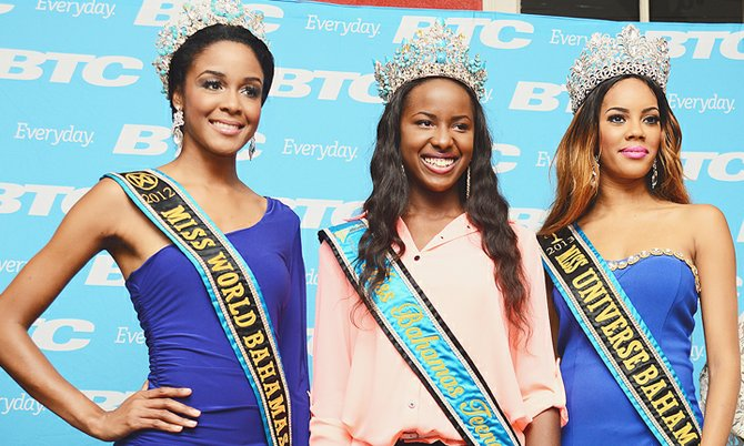 Three Queens: The road to the Miss Bahamas Pageant officially got under way yesterday at John Wailings Distillery. Miss Bahamas World De'Andra Bannister and Miss Bahamas Universe Lexi Wilson are preparing to hand over their crowns next month. They are pictured with the current Miss Bahamas Teenager Rhodesia Johnson.Photo: Lamond Johnson/Tribune staff