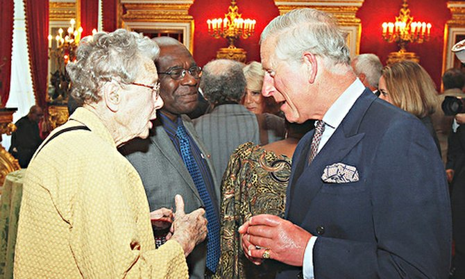 Mallie Lightbourn chats with the Prince of Wales – she was as interested in meeting a homeless man as she was in meeting Prince Charles, said Rev Richard Carter, Associate Vicar at St Martin-in-the Field.