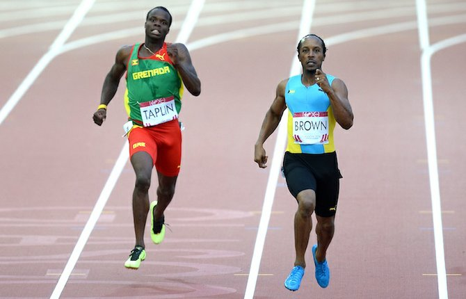Chris Brown and Grenada's Bralon Taplin in the Men's 400m Semi Final at Hampden Park. (AP)