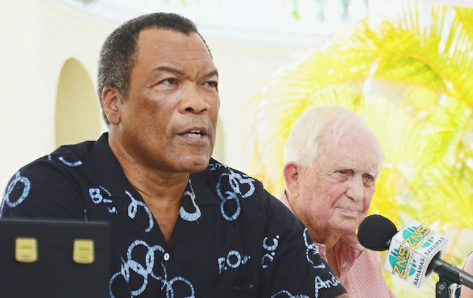 A FITTING HONOUR: Wellington Miller (left), president of the Bahamas Olympic Committee, in conjunction with the Ministry of Sports plan to commemorate the 50th anniversary of the 1964 Tokoyo Olympic Games gold medal performance by Sir Durward Knowles (right) and the late Cecil Cooke.                                                                 Photo by Lamond Johnson/Tribune Staff