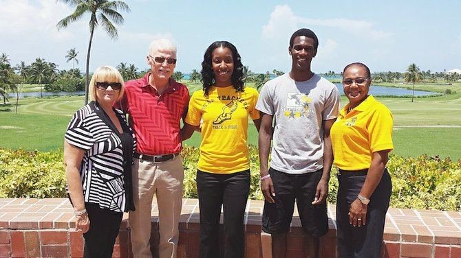 Mr and Mrs JR McDonald is pictured at left, next to athletes Taryn Rolle and Kelson Pierre. At right is Laura Charlton.
