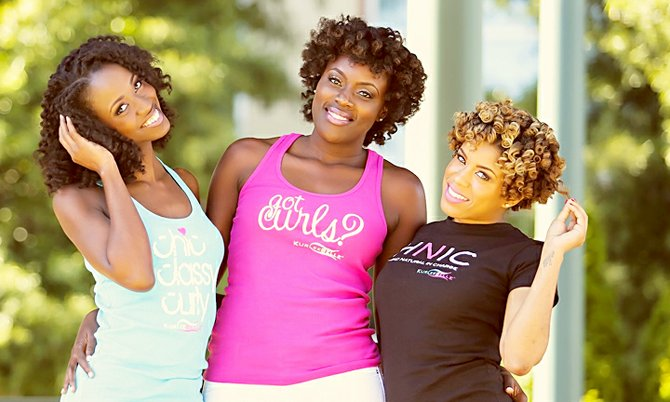 Models show off their natural hair which has been treated with Kurlee Belle products.