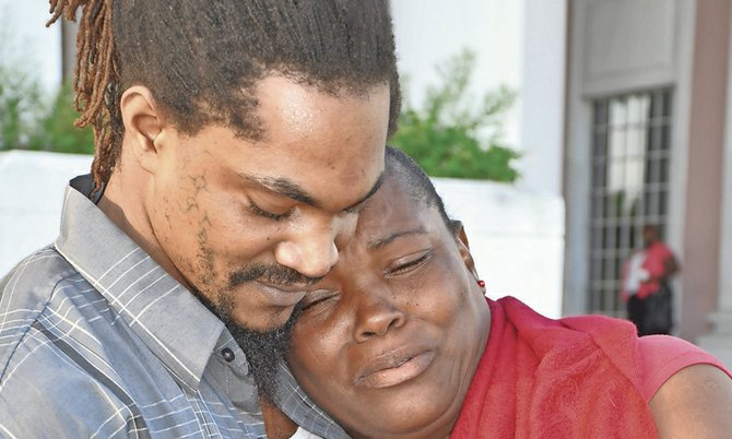 Corderold Wallace, above, receives a hug from his mother after being cleared. Photos: Vandyke Hepburn