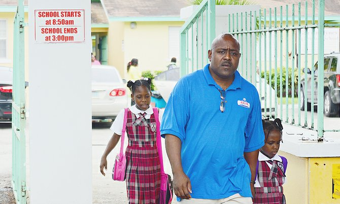 CHILDREN left Garvin Tynes Primary School early yesterday after classes were cancelled following the announcement that one of the school's teachers had died. Photo: Lamond Johnson/Tribune Staff