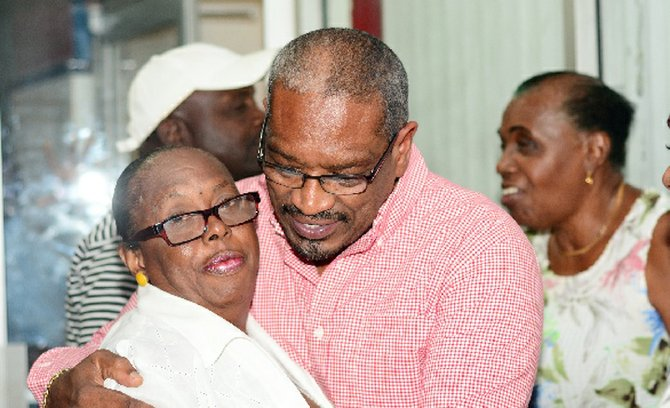 A hug from a supporter for FNM leader Dr Hubert Minnis.
