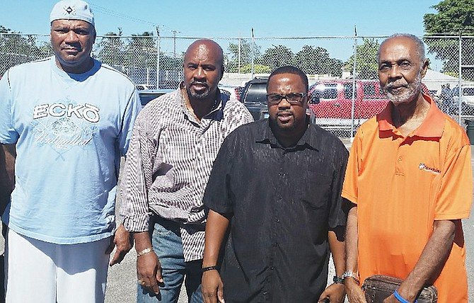 GO POSITIVE: Shown (l-r) are former NFL player Michael Cobb, Apostle Carlos Reid, DJ Councellor and Pastor Geoffery Wood.