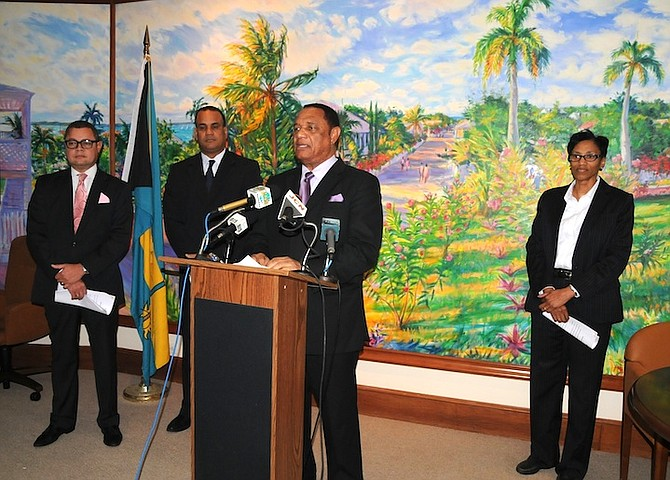 Prime Minister Perry Christie speaks at the press conference yesterday. He is flanked by, from left, Bank of Bahamas Managing Director Paul McWeeney, Minister of State in the Ministry of Finance Michael Halkitis and Governor of the Central Bank Wendy Craigg. (BIS Photo)