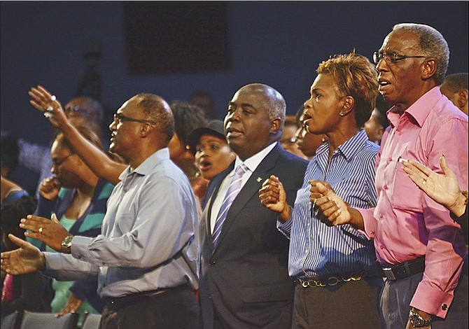 Deputy Prime Minister Philip 'Brave' Davis among the congregation at Bahamas Faith Ministries last night. 