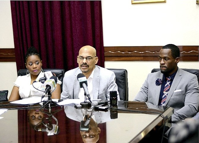 DR MYLES MUNROE'S daughter Charisa and son Chairo (right) with Bahamas Faith Ministries Senior Pastor and Board of Governors chairman Dave Burrows yesterday. Photo: Shawn Hanna/Tribune staff