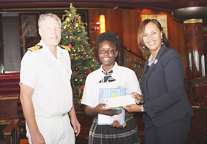 Prisca Charles receives her award of a $3,000 scholarship for her environmental poster.