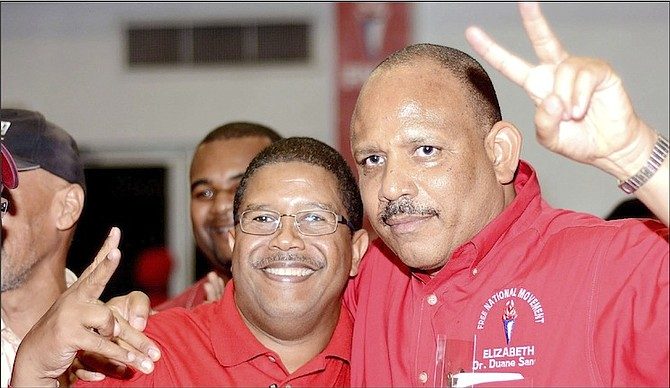 NEWLY elected Free National Movement Deputy Leader K Peter Turnquest (left) with defeated candidate Dr Duane Sands.