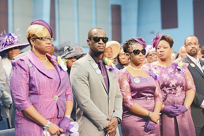 The family of Dr Myles and Ruth Munroe at yesterday's funeral service, including son and daughter Chairo and Charissa, centre. Photo: Shawn Hanna/Tribune Staff