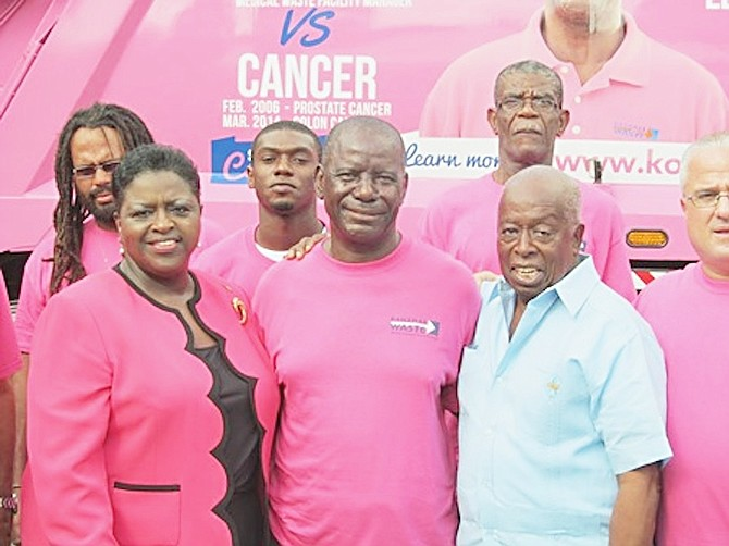 "The USToo Bahamas Chapter Men's Prostate Cancer Group played a critical role in Hartley Strachan's (centre) recovery from prostate cancer.  Chapter leader Valentine Maura (second right) and Social Services Minister Melanie Griffin were on hand for the ""Big Pink"" unveiling. 