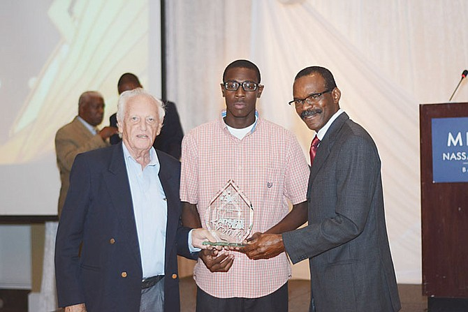 JUNIOR MALE ATHLETE OF THE YEAR LaQuan Nairn receives his award. Also shown are coaches Keith Parker and David Charlton (right).