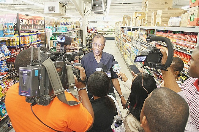 Price Control Commission Chairman Dr EJ Bowe speaks to members of the media yesterday at Super Value on East Street and Robinson Road. Photo: Tim Clarke/Tribune Staff