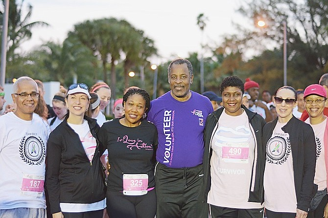 RACING FOR THE CURE: Walkers and runners from all walks of life take part in The Susan G Komen Bahamas Race for the Cure 5-kilometre event on Saturday morning. The route began at Montagu Bay beach and finished at the Atlantis resort on Paradise Island. Photo by Shawn Hanna/Tribune Staff