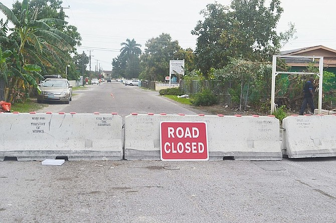 Barricades put in place to close Tucker Road, as part of the plan to develop the College of the Bahamas into a university.