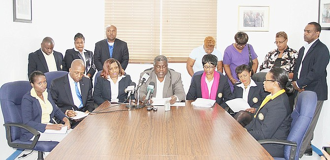 """Bahamas Communications and Public Managers Union President Richard Thompson with Union of Central Bankers officials and attorney Alfred Sears addressing """"unilateral"""" decisions made by Central Bank to change employees' terms of employment.Photos: Tim Clarke/Tribune Staff"""
