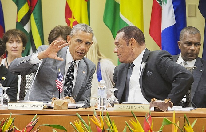 US President Barack Obama talks with Prime Minister Perry Christie at the summit with Caribbean Community (CARICOM) leaders yesterday in Kingston, Jamaica. The president said that will he soon decide whether to remove Cuba from the US list of state sponsors of terrorism now that the State Department has finished a review on the question as part of the move to reopen diplomatic relations with the island nation.Photo: Pablo Martinez Monsivais/AP
