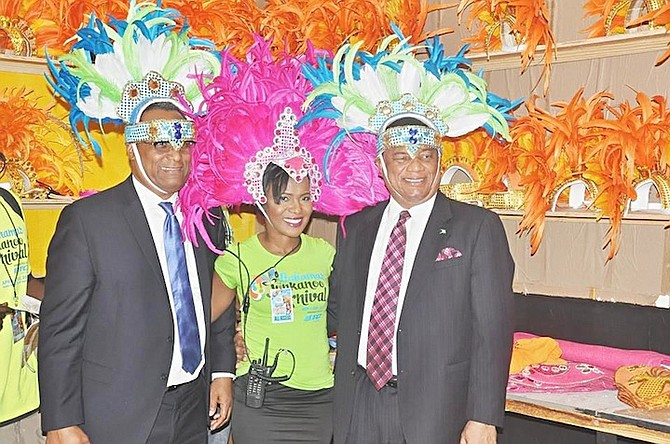 Prime Minister Perry Christie and Minister for Grand Bahama testing out headgear from the Bahamas Junkanoo Carnival workshop.