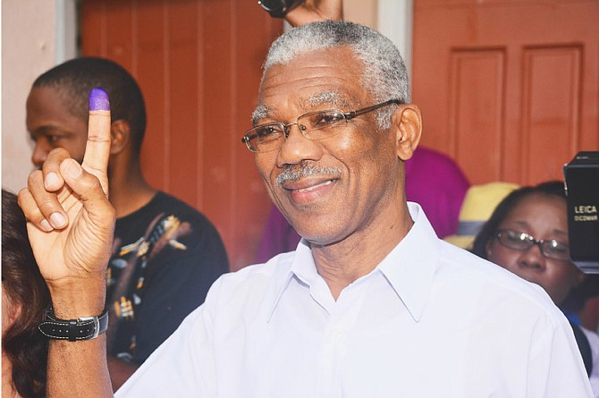 David Granger, of the A Partnership for National Unity and Alliance For Change displays his inked finger after voting in Georgetown last Monday. Mr Granger is the new president of Guyana after ousting the long-time People's Progressive Party administration. 