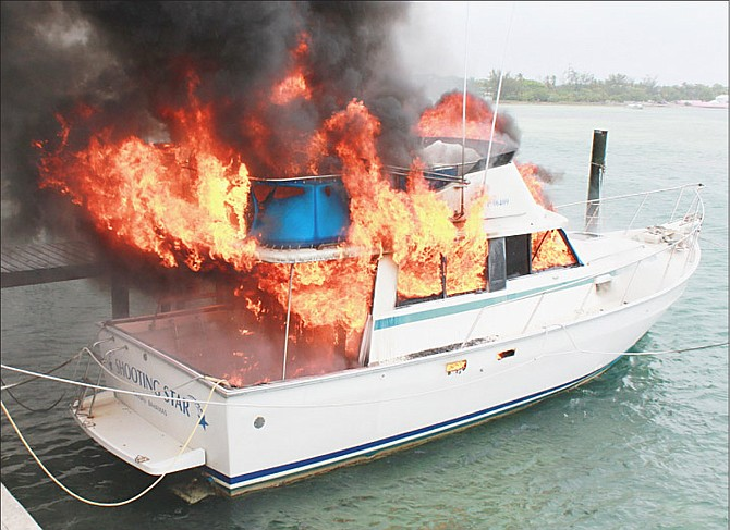 The boat in flames at Dick's Point yesterday. Photo: Ronald Lightbourn