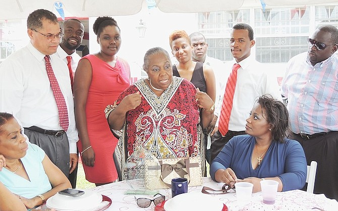 Janet Bostwick, centre, at an FNM lunch on Sunday to mark the 33rd anniversary of her becoming the first woman elected to the House of Assembly.