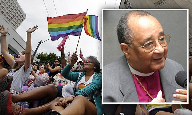 Main picture: Viewers cheer at the 41st annual Pride Parade yesterday in Seattle and (inset) retried Anglican Archbishop Drexel Gomez.