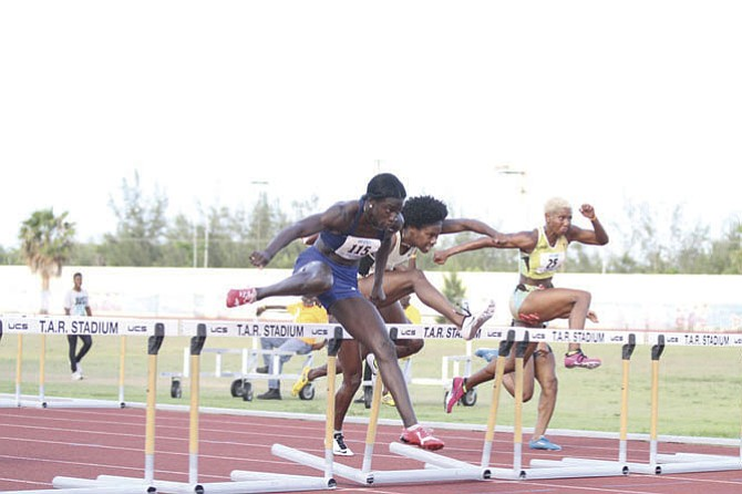 SHOWN (l-r) are Adanaca Brown, Devynne Charlton and Lavonne Idlette of the Dominican Republic in the hurdles.