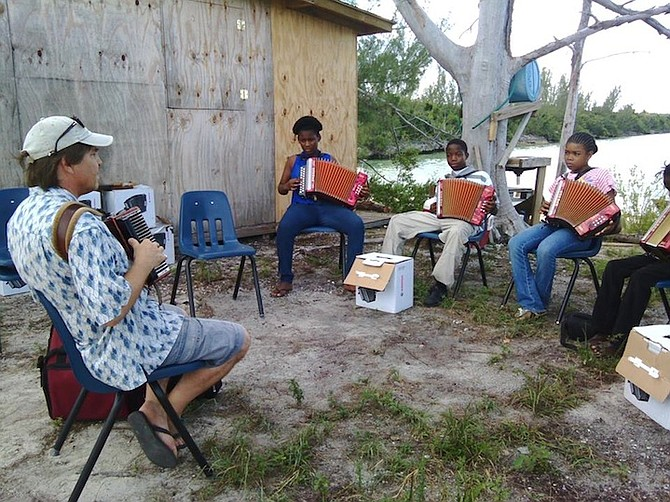 Cat Island youngsters learn to play the accordion with specialist Robert Santiago.