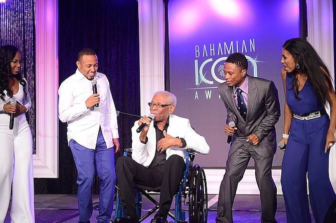 Ronnie Butler on stage at the Bahamian Icon Awards with, from left, Wendi Lewis, Osano Neely, Dyson Knight and Angelique Sabrina. 