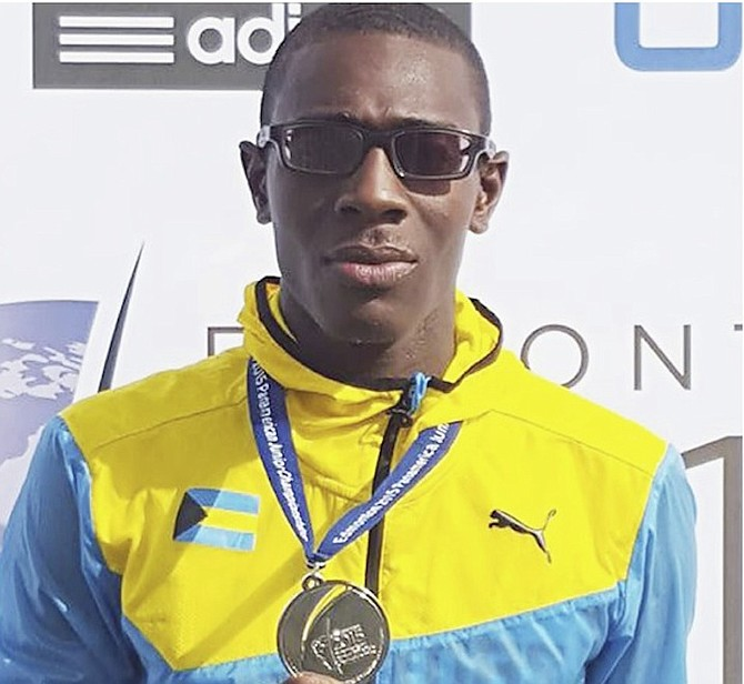 SWEET SILVER: Laquan Nairn shows off his silver medal that he won in the long jump at the Pan Am Junior Track and Field Championships in Edmonton, Canada.