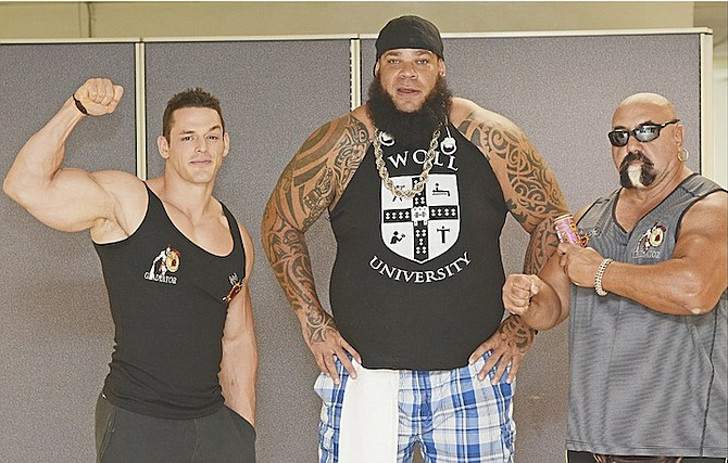 THE TRIBUNE VISIT: Shown (l-r) are Jessie 'Mr Pec-Tacular' Godderz, Brodus 'Tyrus' Clay and Gladiator Championship Wrestling president Nick Cara. The wrestlers are expected to put on a show at Arawak Cay on Saturday, August 29.                                                           