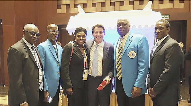 "Bahamian participants at the IAAF Congress are pictured with newly elected president, Sebastian Coe (fourth from left). Shown (l-r) are Frank ""Pancho"" Rahming, Foster Dorsett, Pauline Davis-Thompson, Sebastian Coe, Mike Sands and Carl Oliver."