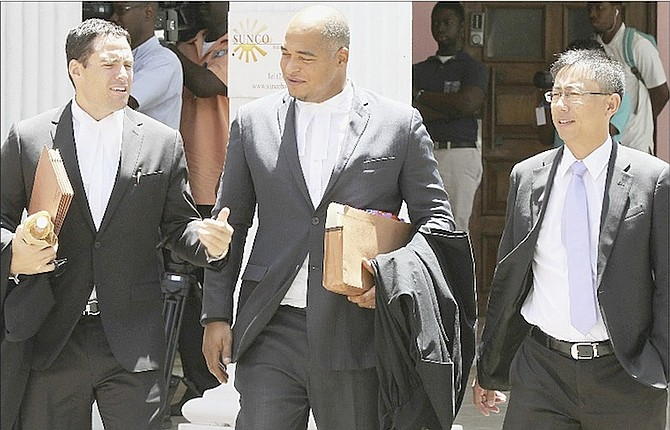Lawyers outside court yesterday during hearings on liquidation proceedings for Baha Mar.  Photo: Tim Clarke/Tribune Staff