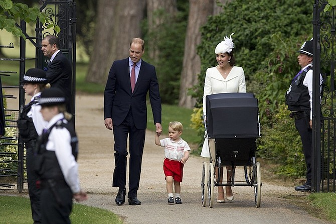 Britain's Prince William, Kate, the Duchess of Cambridge, and their son, Prince George, walk with their daughter Princess Charlotte in a pram. (AP)