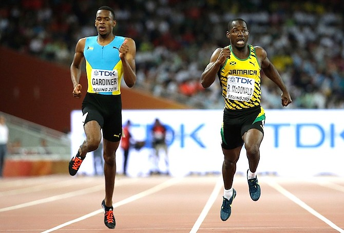 Steven Gardiner and Jamaica's Rusheen McDonald (right) compete in the men's 400m semifinal at the World Athletics Championships at the Bird's Nest stadium in Beijing. (AP)