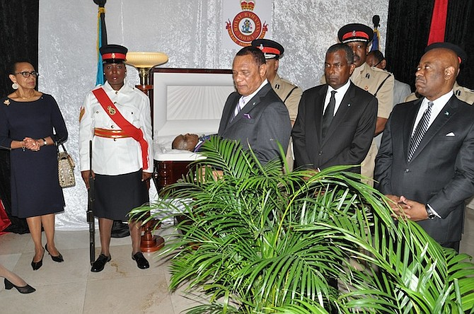 Prime Minister Perry Christie, Immigration Minister Fred Mitchell and Tourism Minister Obie Wilchcombe at the lying in repose of Sir Albert Miller at the Grand Bahama Police Headquarters on Friday. Photo: Vandyke Hepburn/BIS
