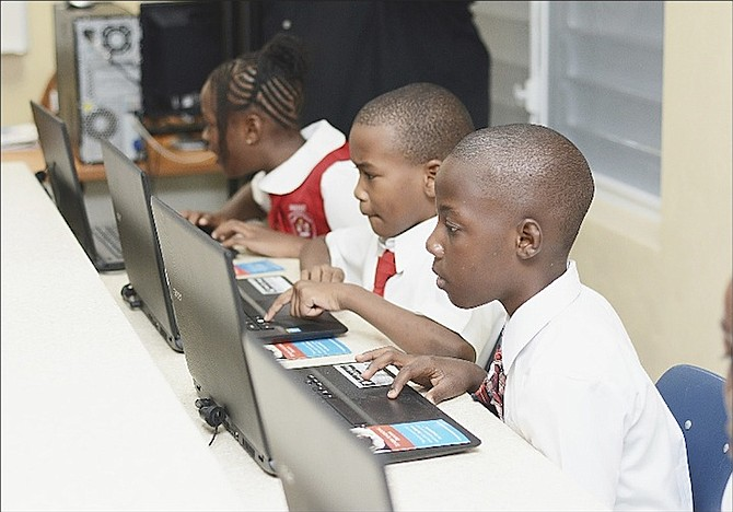 Students using the laptops in the new computer lab at EP Roberts Primary School.
