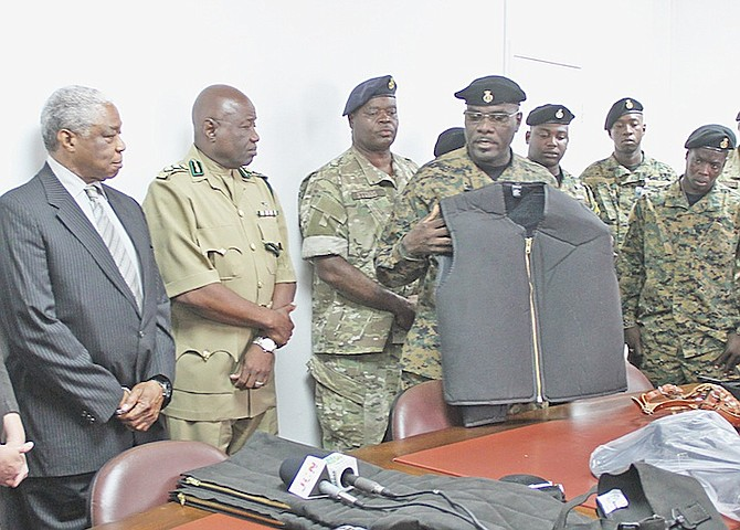Corrections Officer David Rolle explains the use of some of the items that have been donated to The Bahamas by the US Embassy, as Minister of National Security Dr Bernard Nottage watches on yesterday.