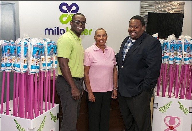Pictured at the launch of 'Project Pink Mop' are Kent Forbes, brand manager at Milo Butler; Andrea Sweeting, president of Sister Sister, and Franklyn Butler, managing director of Milo Butler. 