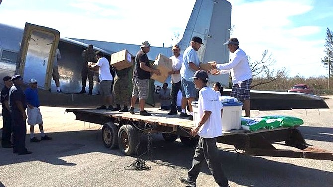 Supplies being unloaded in Deadman's Cay, Long Island this morning.