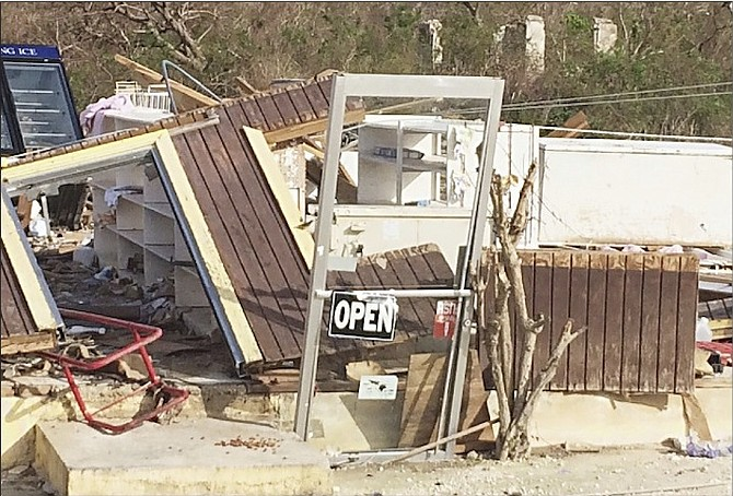 The remnants of a store on the way south to Gordon's in Long Island, with the 'Open' sign still showing.