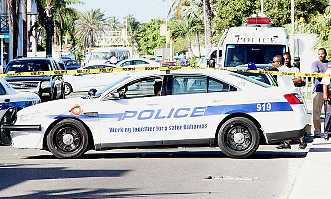 A POLICE car at the scene of one of the many shootings that has plagued The Bahamas, with a new record murder count having been set this year.