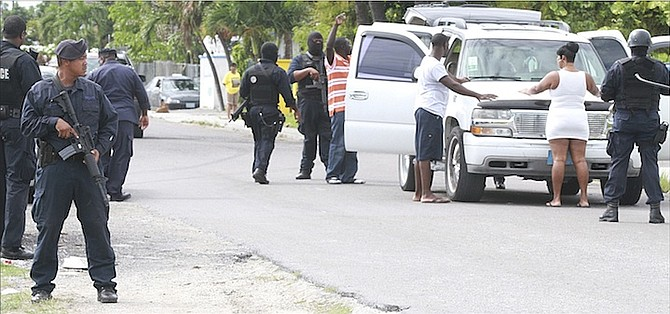 Armed officers in Nassau Village yesterday afternoon as police locked down Nassau Village following the latest murder in The Bahamas, the 134th this year. Photo: Tim Clarke/Tribune Staff
