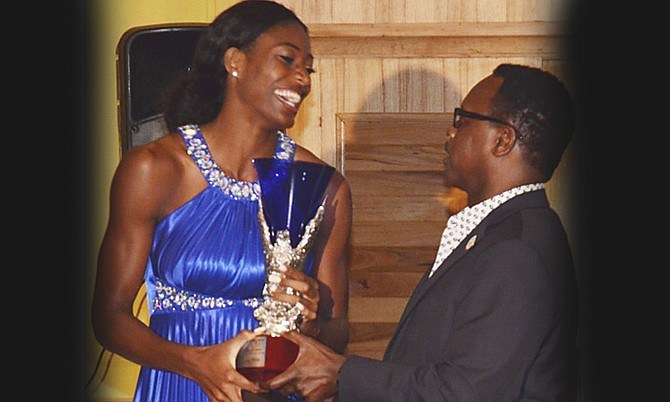 SHAUNAE MILLER receives the Prime Minister's Award for Most Outstanding Athlete for 2015 from Minister of Youth, Sports and Culture Dr Daniel Johnson.