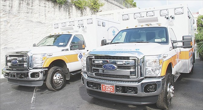 The two new ambulances handed over to the Public Hospitals Authority yesterday.  Photos: Tim Clarke/Tribune Staff