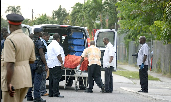 The body is removed from the scene in Nassau Village.